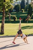 fitness girl making stretching at park at morning sunshine royalty free stock photography