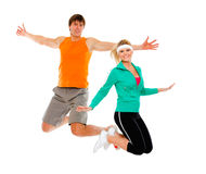 Fitness girl and man in sportswear jumping Royalty Free Stock Photos