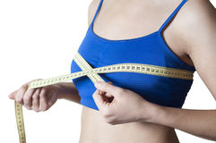 Fitness girl measured her breast Royalty Free Stock Photo