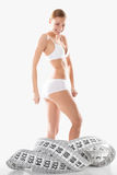 Fitness girl and measurement figures Stock Photography