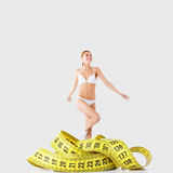Fitness girl and measurement figures Royalty Free Stock Photos