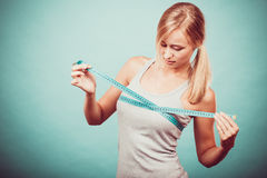 Fitness girl measuring her breasts Royalty Free Stock Photos