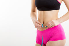 Fitness girl measuring her perfect shapeed beautiful waist. Stock Images
