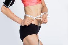 Fitness girl measuring her waist Stock Photo