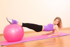 fitness girl with pink ball exercising Royalty Free Stock Image