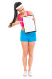 Fitness girl pointing on blank clipboard Stock Image