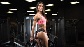 Fitness girl posing in the gym Stock Photo