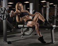 Fitness girl posing in the gym Royalty Free Stock Images