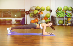 Fitness girl pressed. Fitness, girl pushed in the gym. The concept of Health, sports Stock Images