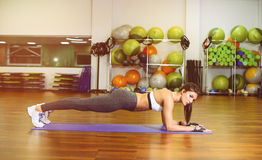 Fitness girl pressed. Fitness, girl pushed in the gym. The concept of Health, sports Stock Photography