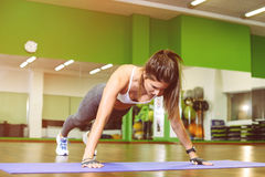 Fitness girl pressed. Fitness, girl pushed in the gym. The concept of Health, sports Royalty Free Stock Photo