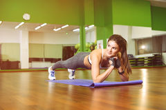 Fitness girl pressed. Fitness, girl pushed in the gym. The concept of Health, sports Royalty Free Stock Photos