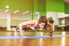 Fitness girl pressed. Fitness, girl pushed in the gym. The concept of Health, sports Stock Image