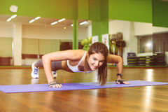 Fitness girl pressed. Fitness, girl pushed in the gym. The concept of Health, sports Royalty Free Stock Image