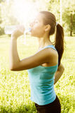 Fitness girl refreshment Stock Images