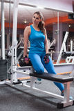 Fitness girl relaxing in the gym Stock Photo