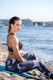 Fitness girl relaxing  urban waterfront Stock Photo