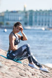 Fitness girl relaxing  urban waterfront in Saint-Petersburg Royalty Free Stock Photos
