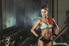 Fitness girl resting in the gym royalty free stock photo