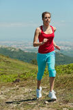 Fitness girl running in mountains Royalty Free Stock Images