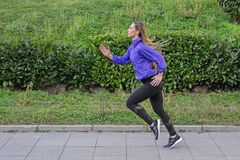 Fitness Girl Running outdoors Stock Photography
