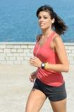 Fitness girl running on summer Royalty Free Stock Photos