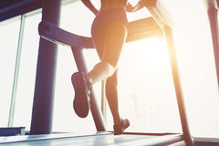 Fitness girl running on treadmill Royalty Free Stock Image