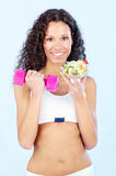 Fitness girl with salad and weight Stock Images