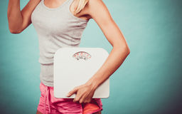 Fitness girl with scales. Weight loss. stock image