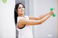 Fitness Girl. Sexy athletic girl working out in gym. Fitness woman doing exercise stock photos