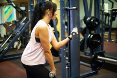 Fitness Girl. Sexy athletic girl working out in gym. Fitness woman doing exercise royalty free stock photography