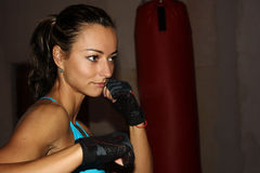 Fitness girl shadow boxing at the gym. Fit female boxing training at a fitness centre Royalty Free Stock Photography