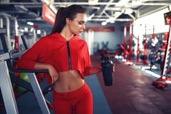 Fitness girl with shaker posing in the gym.  Stock Photos