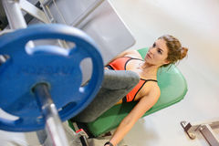 Fitness girl shakes her legs. The concept of health, sports Stock Image