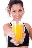 Fitness girl showing a fresh juice,focus on girl Royalty Free Stock Photos
