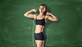 Fitness girl showing her biceps with drawn fat around body Stock Photos