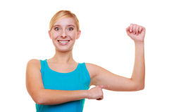Fitness girl showing her muscles. Power. Stock Photo