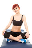 Fitness girl sitting on the floor, full length Royalty Free Stock Photography