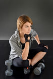Fitness girl sitting on the floor realxing Stock Photos