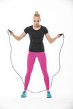 Fitness girl with skipping rope Stock Images