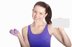 Fitness girl smiling happy showing empty blank paper sign Royalty Free Stock Image