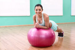 Fitness girl in sport club Stock Images
