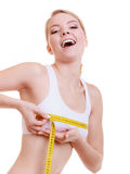 Fitness girl sporty woman measuring her bust size isolated Stock Images