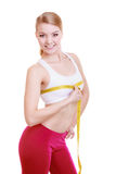 Fitness girl sporty woman measuring her bust size isolated. Fitness girl sporty smiling woman measuring her bust size chest with measurement tape isolated on Stock Photos