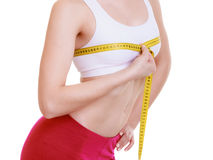 Fitness girl sporty woman measuring her bust size isolated Royalty Free Stock Image