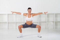 Fitness girl stretching Royalty Free Stock Photo