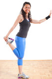 Fitness girl stretching legs Royalty Free Stock Photo