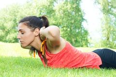 Fitness girl stretching outdoors stock images