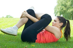 Fitness girl stretching outdoors Stock Photography