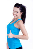 Fitness girl. Studio shot of a Fitness girl isolated on white holding a bottle of water in her hand and smiling Stock Images